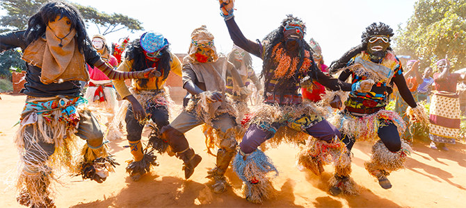 Malawi locals celebrate by dancing to traditional Malawian songs.