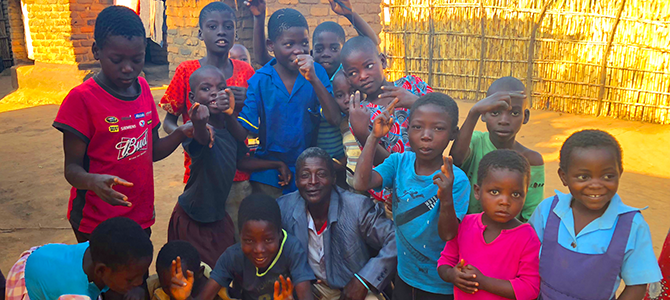 A group of children from the Community Based Child Care in Malawi pose for a picture.