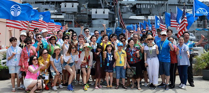 Greater China Nu Skin Sales Leaders pose for a picture in front of the USS Missouri Battleship on Ford Island.